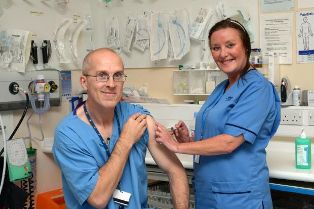 Cumnock Chronicle: Dr Crawford McGuffie, Medical Director, leads by example getting his flu jab in 2014