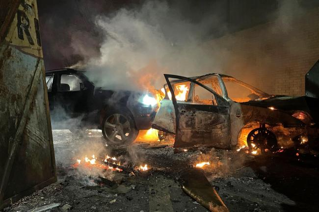 Cars which were set alight during another night of trouble in Belfas