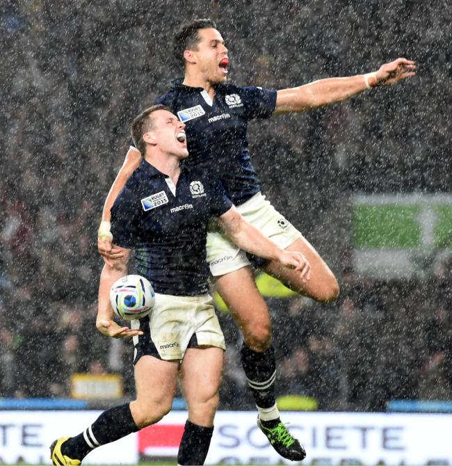 Mark Bennet celebrates with Sean Maitland after scoring at the World Cup.