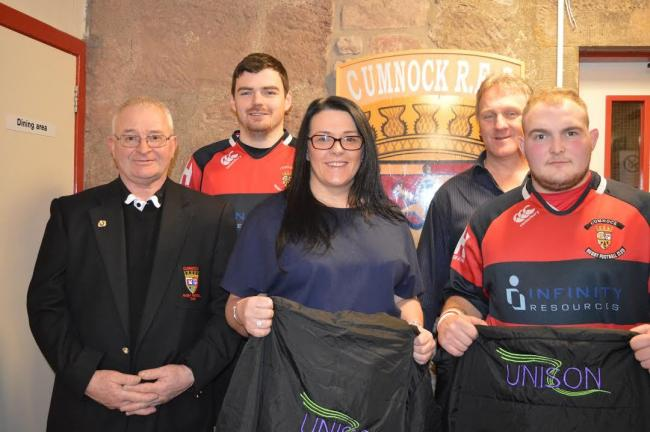 Unison representatives Wilma Gilroy and John Calder attended the game to present new substitute jackets bearing the Unison logo to Cumnock RFC president Bobby Horton.