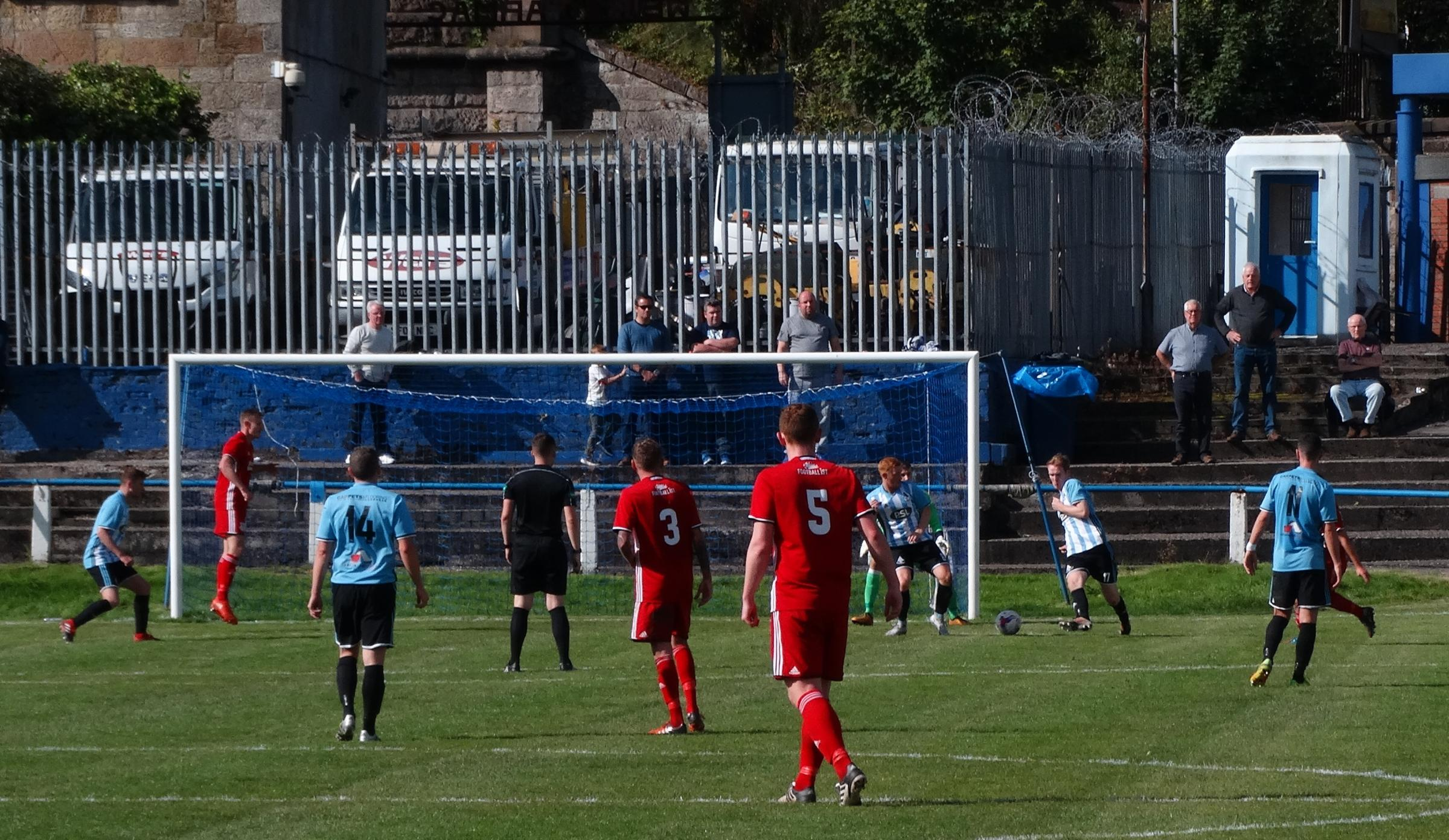 GOALMOUTH ACTION: Davie Gray, obscured behind Arthurlie no11, is about to net Glens' equaliser. Picture courtesy of Robert Burns