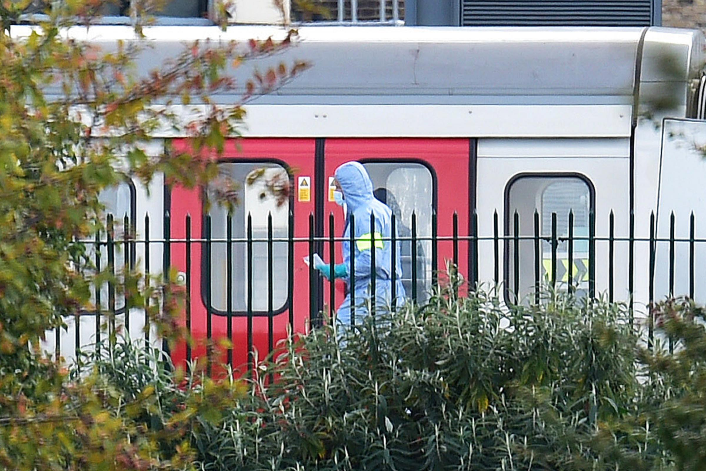 A forensics officer on the platform at Parsons Green station in west London (Dominic Lipinski/PA)