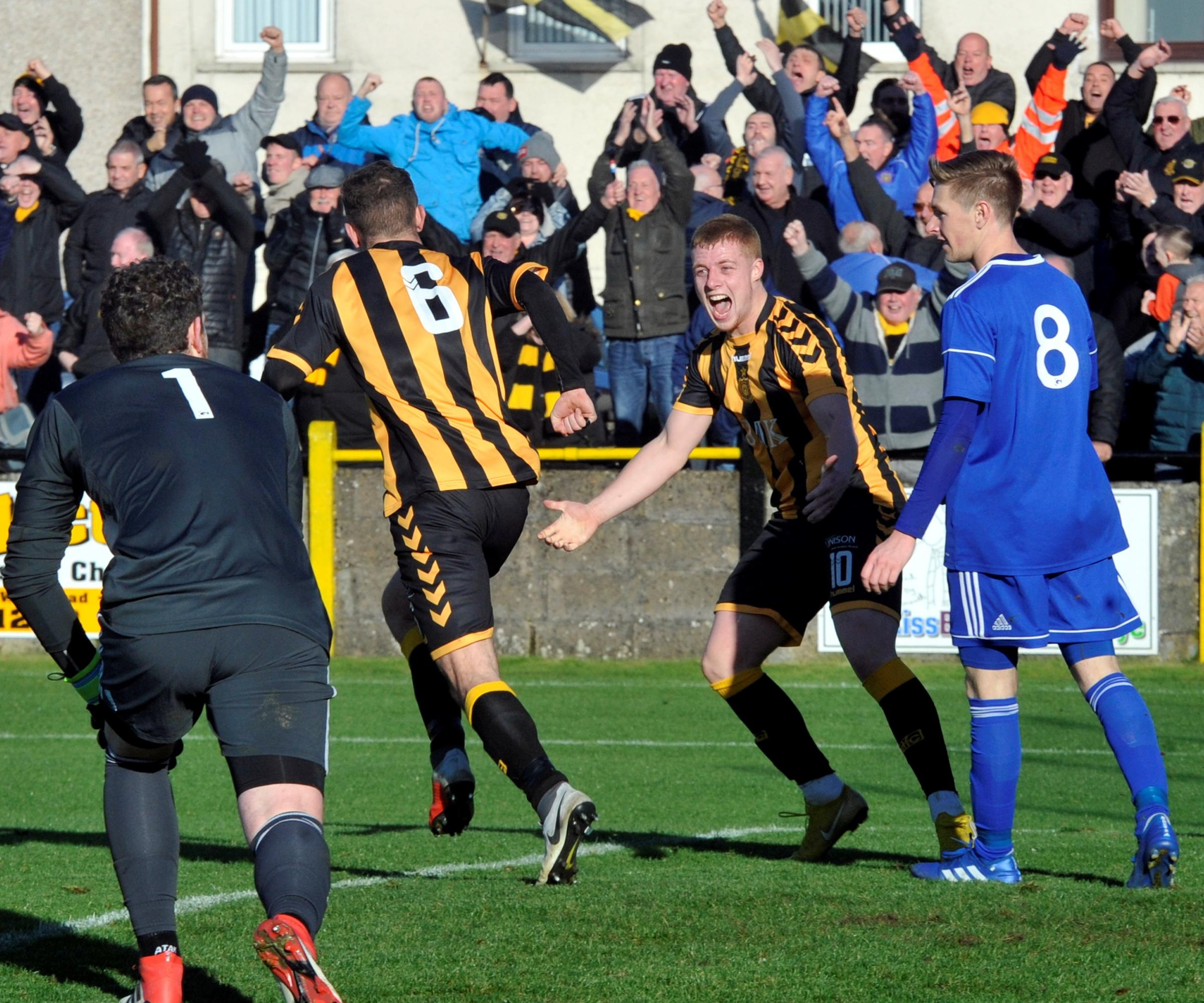 OPENING GOAL: Talbot's Stephen Wilson celebrates with Calvin Kemp after scoring against Cove Rangers