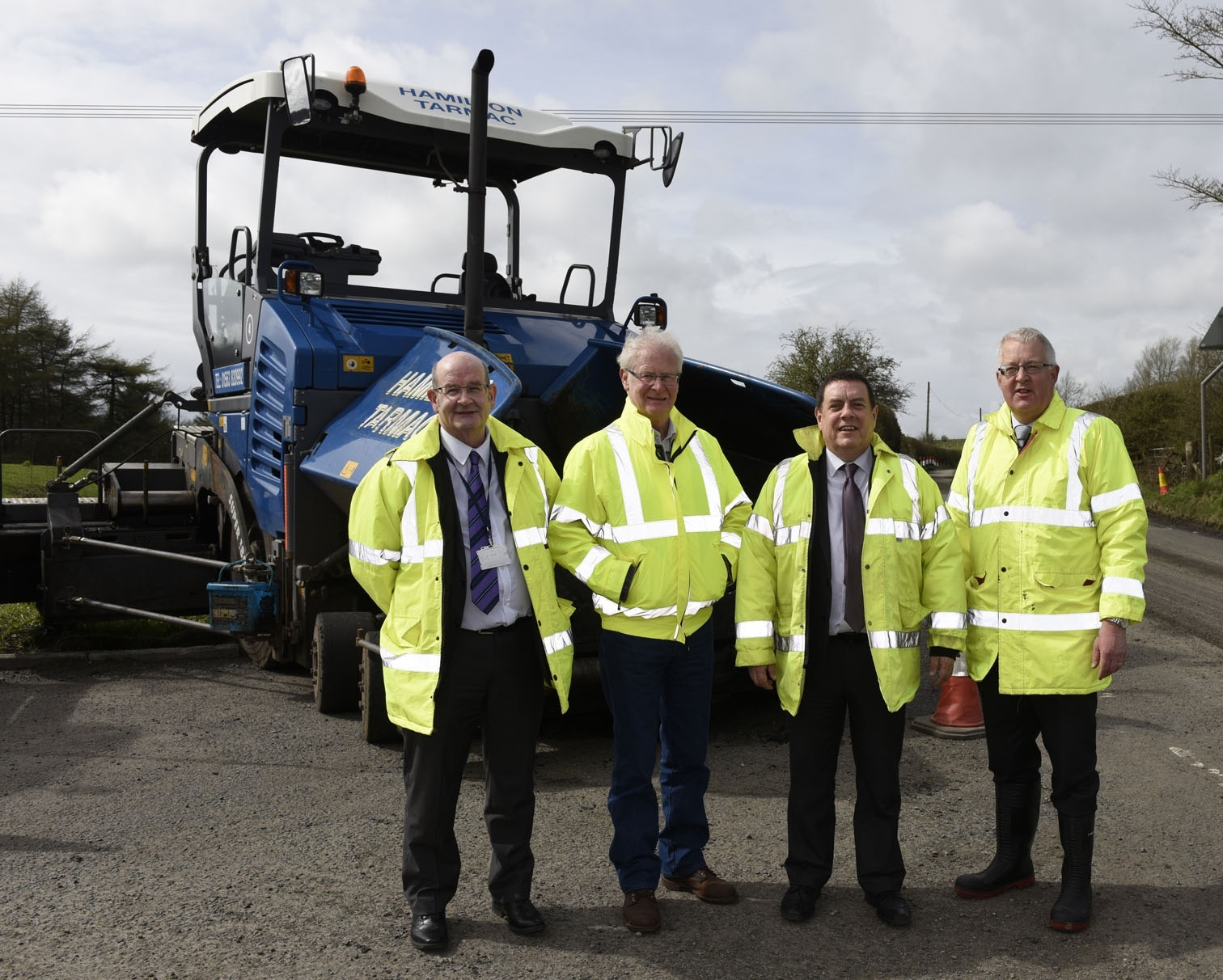 ROAD REPAIRS: Councillors Douglas Reid and Jim Roberts with Stewart Turner and Kevin Braidwood from the Ayrshire Roads Alliance.