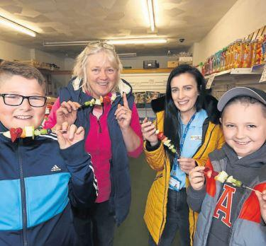 Youngsters encourage more people to visit Cumnock town centre by helping out in shops