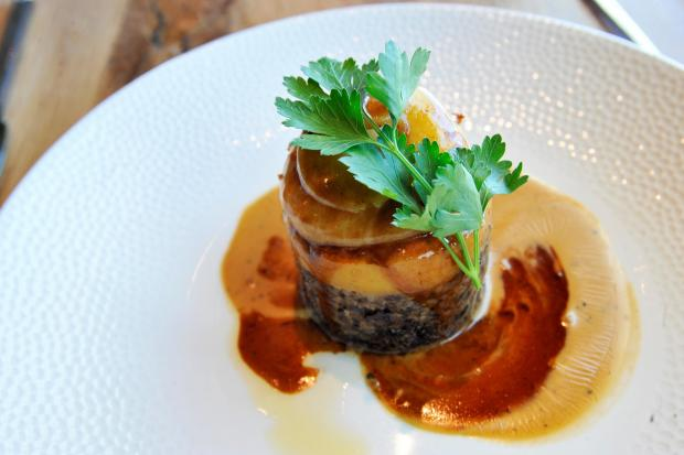Cumnock Chronicle: Haggis gateau with bashed neeps, champit tatties, whisky jus and four peppercorn sauce.