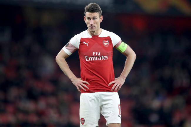 Former Arsenal striker Ian Wright has heavily criticised Laurent Koscielny, pictured, for refusing to go on the pre-season tour of the United States