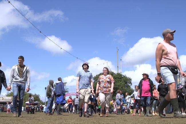 Attendees arrive at the Isle of Wight Festival (Ed Lawrence/PA)